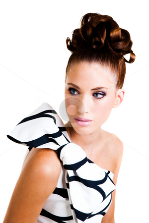 Young Woman in Haute Couture Attire - Isolated stock photo, Portrait of a young woman. Her hair is styled in an updo and she is wearing a black and white dress with a large bow on the shoulder. Vertical shot. Isolated on white. by Angela Hawkey