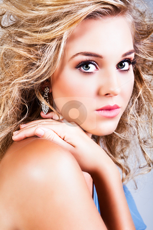 Attractive Young Woman Model With Wind Blown Hair stock photo, Portrait of a beautiful young woman with blonde, windblown hair. Vertical shot. by Angela Hawkey