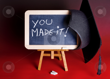 Success cap stock photo, Graduation cap hanging on a blackboard with congratulations by Anneke