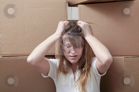 Moving stress stock photo, Caucasian woman overwhelmed by the stress of moving by Christy Thompson