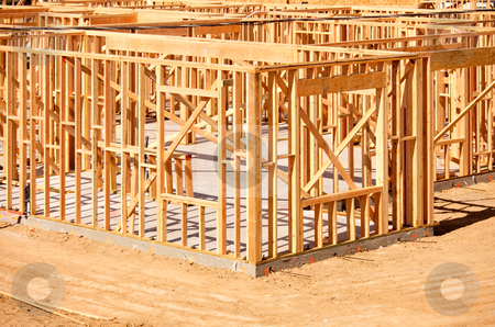 New Home Construction Framing stock photo, New Residential Home Construction Framing Site Just Before the Roofing Phase. by Andy Dean