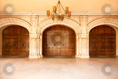 Majestic Classic Arched Doors with Chandelier? stock photo, Three Majestic Classic Arched Doors with Chandelier. by Andy Dean