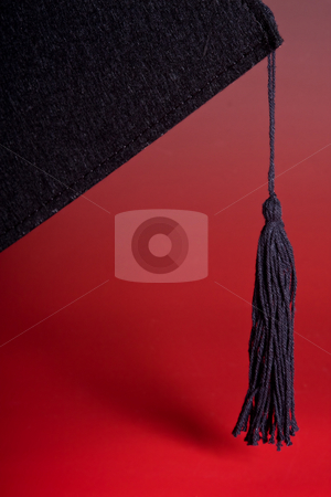 Black tassel stock photo, Detail of the black tassel of a graduation cap by Anneke