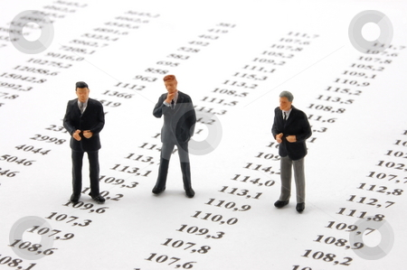 Business man over economic chart stock photo, Business man over economic chart in conversation by Gunnar Pippel
