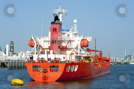 Oil Tanker stock photo, Moored oil tanker in an industrial harbor near a refinary by Corepics VOF