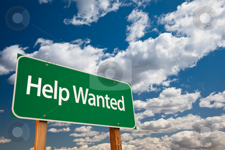 Help Wanted Green Road Sign stock photo, Help Wanted Green Road Sign with Copy Room Over The Dramatic Clouds and Sky. by Andy Dean