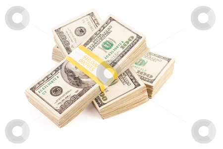 Stacks of One Hundred Dollar Bills Isolated stock photo, Stacks of Ten Thousand Dollar Piles of One Hundred Dollar Bills Isolated on a White Background. by Andy Dean
