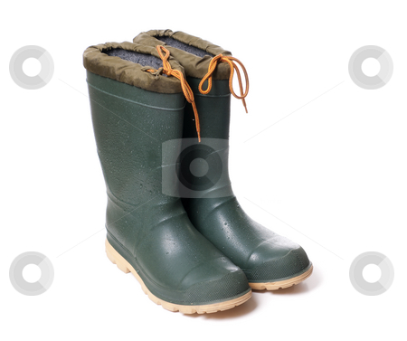 Rubber Boots stock photo, A pair of rubber boots with water drops on them, isolated against a white background. by Richard Nelson