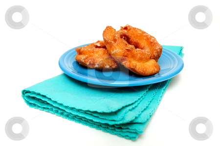 Glazed Buttermilk Doughnut stock photo, Two glazed buttermilk doughnuts on a turquoise saucer and napkin on a light colored background by Lynn Bendickson
