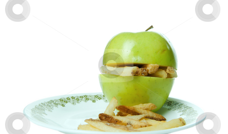 Unhealthy Eating stock photo, Concept image of unhealthy eating with an apple making a sandwich of french fries. by Richard Nelson