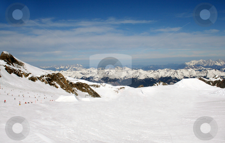 Alpine ski slope stock photo, Alpine ski slope and mountains, Crans Montana, Switzerland. by Martin Crowdy