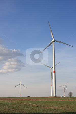 Wind turbines under blue sky stock photo, wind turbines in rural german landscape by Torsten Lorenz