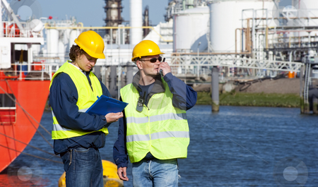 Harbor inspection stock photo, Two dockers during a routine inspection of an industrial harbor by Corepics VOF