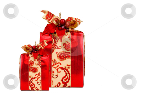 Two Red Presents with clipping path stock photo, Two red holiday presents beautifully decorated with ribbon and adornments. Clipping path included. by Greg Blomberg