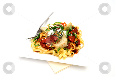 Roasted Tomato Fettuccini stock photo, Fettuccini topped with tomatoes roasted in olive oil and italian herbs and spices with marinated artichoke hearts sliced fresh basil and feta cheese by Lynn Bendickson