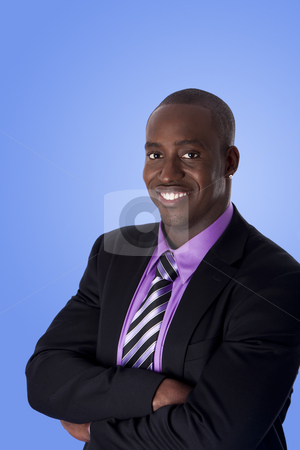 Happy smiling African American business man stock photo, Handsome happy African American corporate business man smiling, wearing black suit with purple shirt, arms crossed,  isolated. by Paul Hakimata
