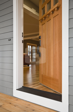 Open Front Door of a Home stock photo, Exterior view of the open front door to a residence with the interior viewable from the outside. Vertical shot. by David Papazian