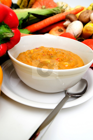 Fresh Veggies And Vegetable Soup stock photo, A bowl of warm creamy vegetable soup great for a cold winter day or a light meal with an assortment of fresh veggies in the background by Lynn Bendickson