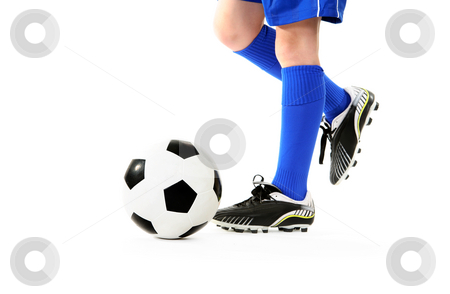 Boy kicking soccer ball stock photo, Boy kicking a soccer ball.  White background. by Leah-Anne Thompson