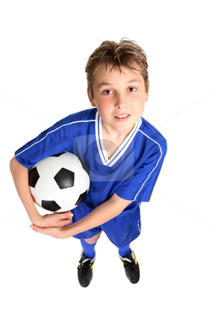 Boy with soccer ball stock photo, A boy in soccer uniform holding a soccer ball.  White background. by Leah-Anne Thompson
