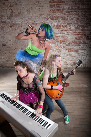 Female punk rock band stock photo, Young all girl punk rock band performing by Scott Griessel
