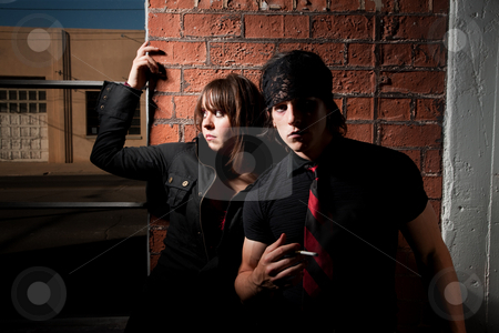 Sketchy Couple stock photo, Sketchy Couple in a Brick Warehouse Near Window by Scott Griessel