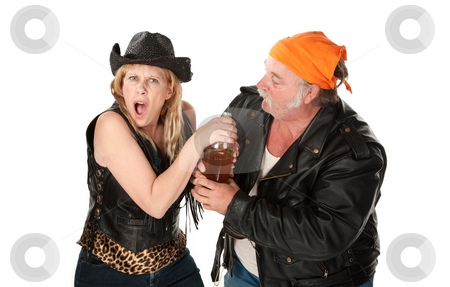 Motorcyle gang couple arguing about a beer bottle stock photo, Motorcyle gang couple arguing about a beer bottle by Scott Griessel