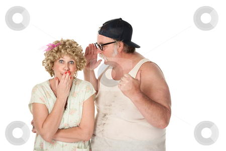 Man sharing a secret with a woman on white background stock photo, Funny man sharing a secret with a woman on white background by Scott Griessel