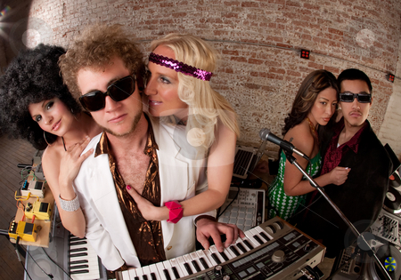 Handsome DJs stock photo, Handsome DJs surrounded by ladies at a 1970s Disco Music Party by Scott Griessel