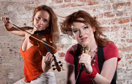 Female musicians stock photo, Two female musicians with violin and vocals by Scott Griessel