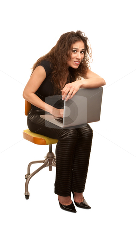 Pretty Woman with computer stock photo, Pretty woman in black with computer seated on orange office chair by Scott Griessel