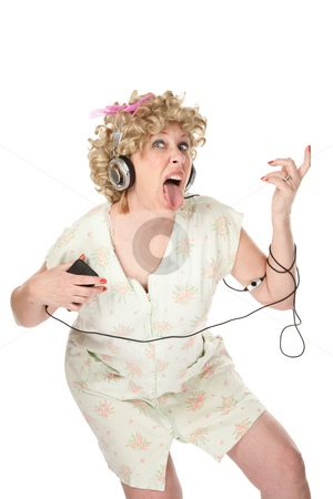 Funny woman in nightgown listening to music stock photo, Funny woman in nightgown listening to music and dancing by Scott Griessel