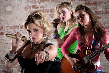 Punk Rock Band stock photo, All-girl punk rock band performs in front of a brick background by Scott Griessel