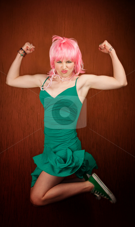 Pretty woman jumping and flexing stock photo, Pretty woman jumping and flexing her muscles by Scott Griessel