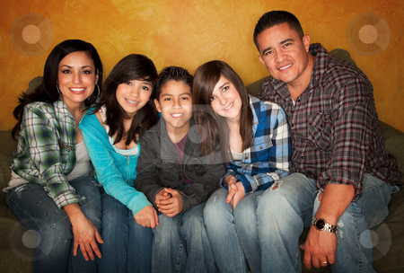 Hispanic family stock photo, Attractive Hispanic Family Sitting on a Green Couch by Scott Griessel