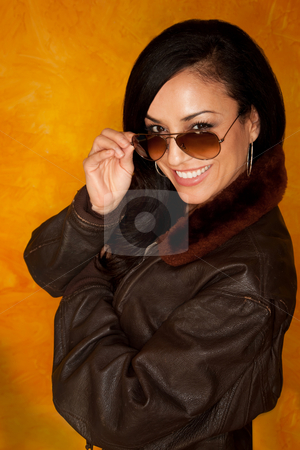 Pretty Latina Woman stock photo, Pretty Latina Woman wearing a brown leather jacket by Scott Griessel