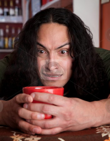 Very tense Latino male stock photo, Very tense Latino male with coffee mug by Scott Griessel