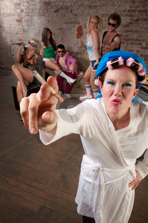 Angry lady in bathrobe stock photo, Angry lady in bathrobe crashing a 1970s Disco Music Party by Scott Griessel