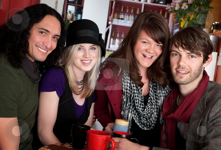 Two couples stock photo, Two couples smiling together in a cafe by Scott Griessel