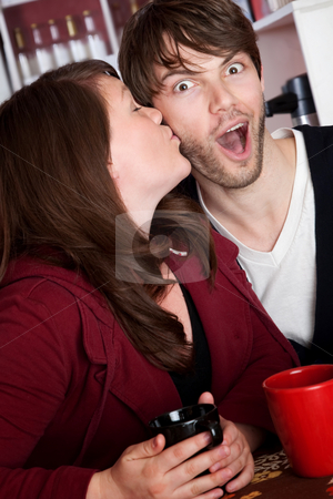 Surprise kiss stock photo, Surprise kiss and coffee at a cafe by Scott Griessel