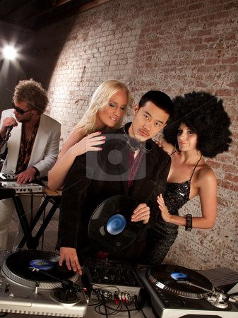Handsome Asian DJ at a 1970s Disco Music Party stock photo, Handsome Asian DJ at a 1970s Disco Music Party by Scott Griessel