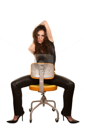 Pretty Woman stock photo, Pretty woman in black seated on orange office chair by Scott Griessel