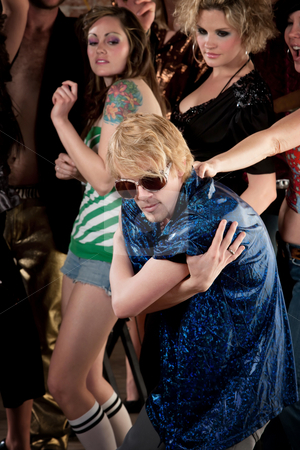 Blonde dancer in blue shirt stock photo, Blonde dancer in blue shirt at a 1970s Disco Music Party by Scott Griessel