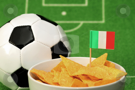 Crispy Snacks stock photo, Soccer ball with crispy snacks in a bowl on green background by Birgit Reitz-Hofmann