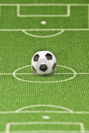 Soccer ball stock photo, Symbol photo toy soccer ball on a football field. Shot in studio. by Birgit Reitz-Hofmann