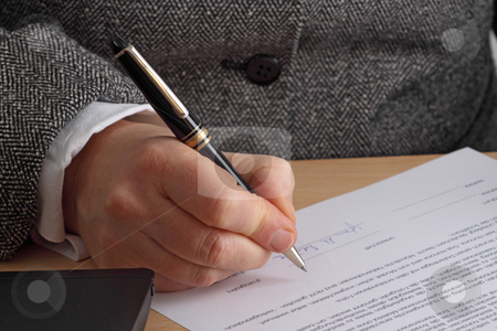 Signature stock photo, Hand with pen and contract. Shot in studio. by Birgit Reitz-Hofmann