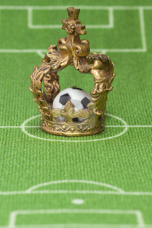 Soccer trophy stock photo, Symbol photo - crown on a soccer field. Shot in studio. by Birgit Reitz-Hofmann