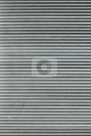 Closed large warehouse door security shutters. stock photo, Closed large warehouse door security shutters. by Stephen Rees