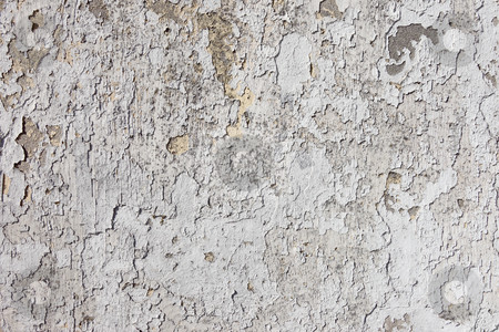 Old weathered flaky white paint on a wall. stock photo, Old weathered flaky white paint on a wall. by Stephen Rees