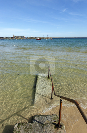 St. Ives clear sea water covering the harbour beach. stock photo, St. Ives clear sea water covering the harbour beach. by Stephen Rees